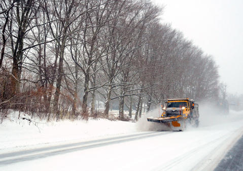 A snow plow tries to keep up with the accumulating snow Saturday on Route 378 in Center Valley.