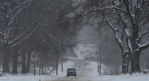 Vehicles slowly drive on Ridge Street. Roads are snowy and slushy in Emmaus on Saturday, January 25, 2014.