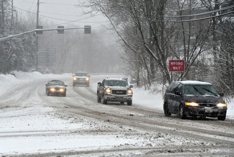 Cars move slowly down a snowy Route 309 Saturday in Center Valley.