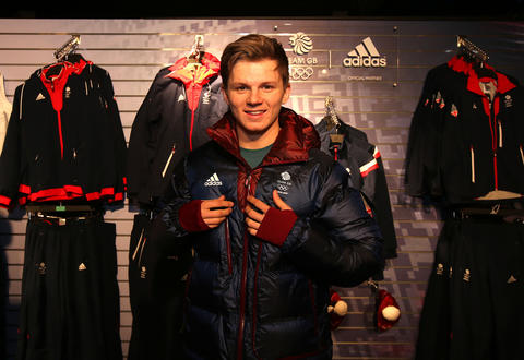 Jamie Nicholls of Great Britain tries on his uniform during the Team GB Kitting Out ahead of Sochi Winter Olympics.