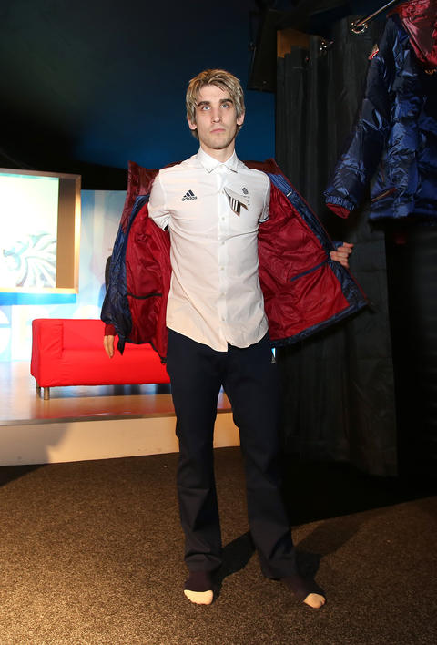 David King of Great Britain tries on his uniform during the Team GB Kitting Out ahead of Sochi Winter Olympics.