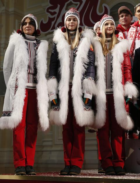 Russian athletes pose for the press during the presentation of the uniforms for the Russian national Olympic team for the upcoming 2014 Winter Olympic Games in Sochi.