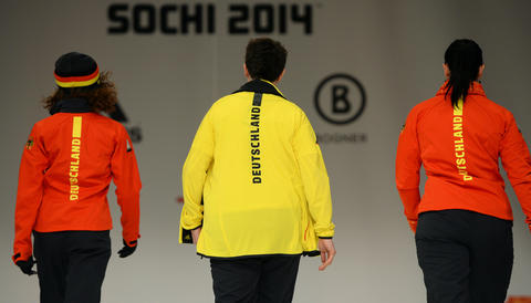 Models and German athletes leave the stage after presenting the official German olympic team's outfit for the next Olympic wintergames in Sochi.
