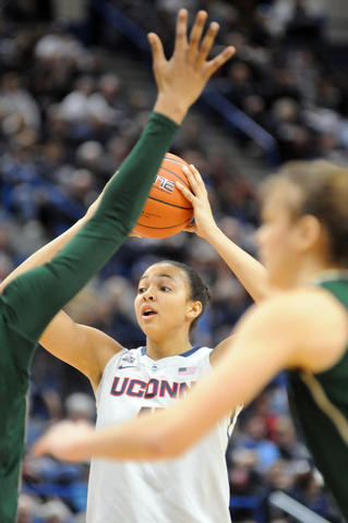 Uconn's Kiah Stokes seeks to pass.