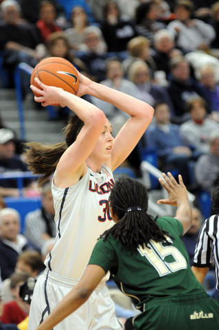 UConn's Breanna Stewart, left, is guarded by Florida's Shavontae Naylor.