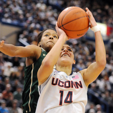 Florida's Courtney Williams, left is on Bria Hartley's shoulder as she takes a shot.