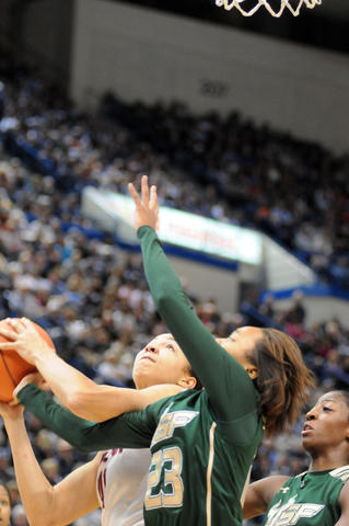 UConn's Kiah Stokes, left and Florida's Shalethia Stringfield vie for the ball.