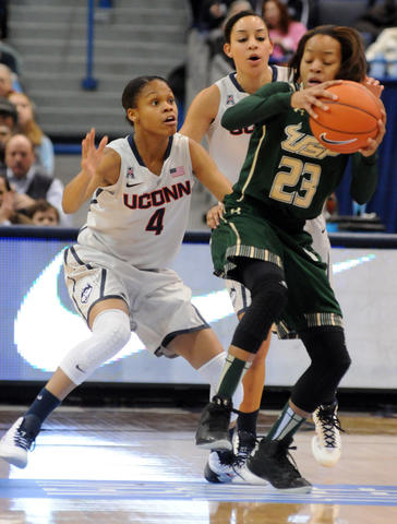 UConn's Moriah Jefferson, left, Bria Hartley and Florida's Shalethia Stringfield on the court as the UConn Women met South Florida at the XL Center in Hartford Sunday.