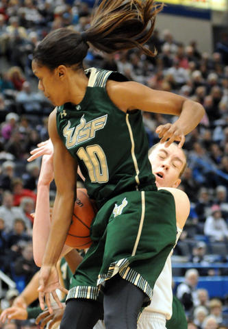 UConn's Breanna Stewart, right, and Florida's Courtney Williams collide as the UConn Women met South Florida at the XL Center in Hartford Sunday.