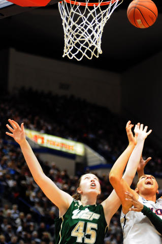 Florida's Katelyn Weber, left and UConn's Stefanie Dolson reach for the ball.
