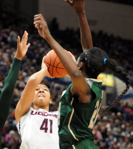 UConn's Kiah Stokes, #41, at center takes a shot.