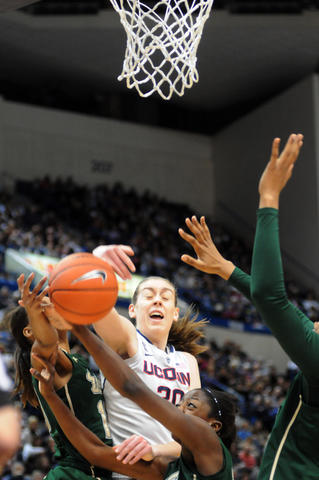 UConn's Breanna Stewart, center,  joins in the search for the ball.