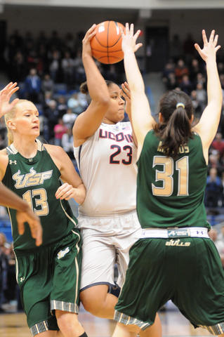 Kaleena Mosqueda-Lewis, center looks for an opening during the first half.