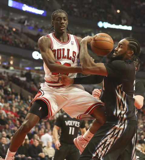 The Timberwolves' Ronny Turiaf defends against Tony Snell during the first half.