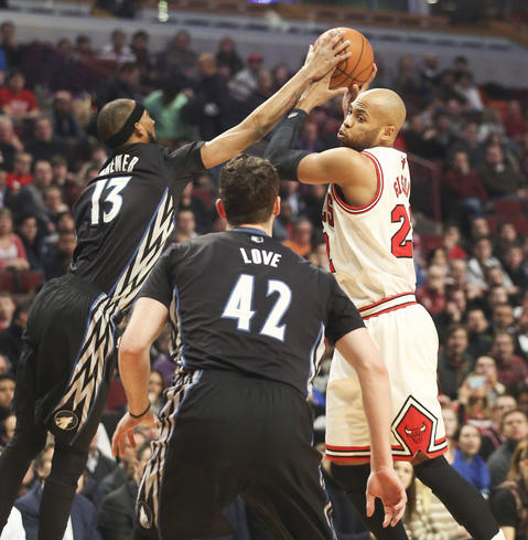 The Timberwolves' Corey Brewer defends against Taj Gibson during the first half.