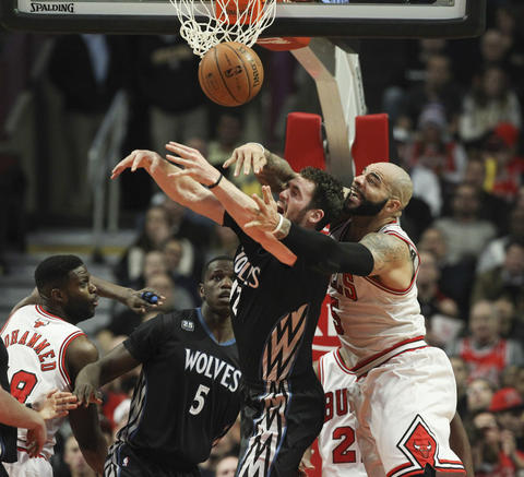 Carlos Boozer fouls the Timberwolves' Kevin Love during the second half.