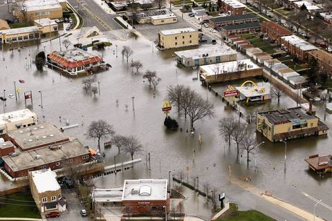 An aerial view shows flooding in the town of Des Plaines along the Des Plaines River.