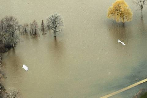 A flooded athletic field is seen in an aerial view in Gurnee near the Des Plaines River.