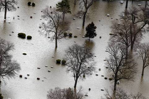A flooded cemetery is viewed from the air near FOrest Park along the Des Plaines River.