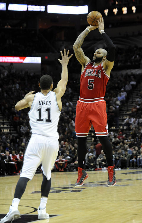 Carlos Boozer shoots against the Spurs' Jeff Ayers during the second half.