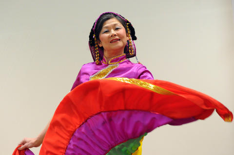 Julie Lai of The Asian Performing Arts group rehearsed for their performance at the Enfield Heritage Fair at the Welles Turner Glastonbury Memorial Library in Glastonbury Wednesday Jan. 29.