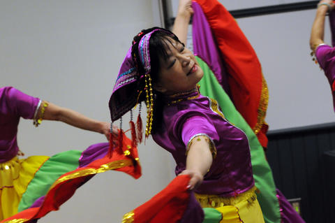 Stephanie Sum of The Asian Performing Arts group rehearsed for her performance at the Enfield Heritage Fair at the Welles Turner Glastonbury Memorial Library in Glastonbury Wednesday Jan. 29.