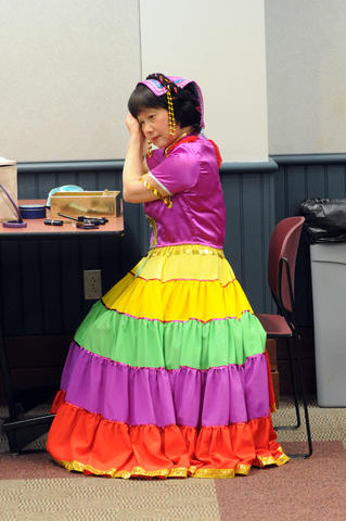 Yuying Xu of The Asian Performing Arts group gets ready for rehearsal for her performance at the Enfield Heritage Fair at the Welles Turner Glastonbury Memorial Library in Glastonbury Wednesday Jan. 29.
