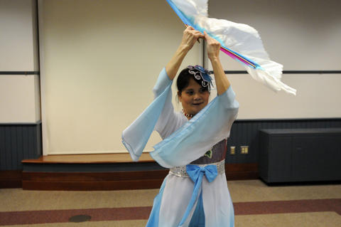 une Liu of Windsor of The Asian Performing Arts group rehearsed for her performance at the Enfield Heritage Fair at the Welles Turner Glastonbury Memorial Library in Glastonbury Wednesday Jan. 29.