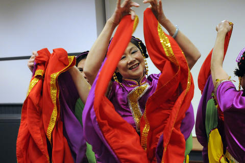 Julie Lim of the Asian Performing Arts group rehearsed for their performance at the Enfield Heritage Fair at the Welles Turner Glastonbury Memorial Library in Glastonbury Wednesday Jan. 29.