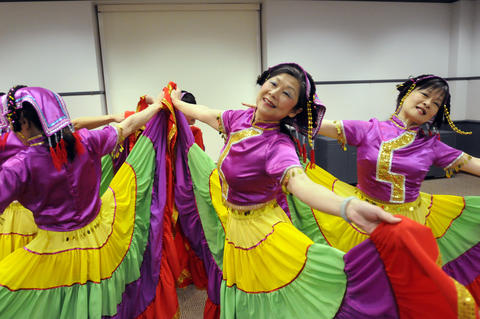 Julie Lai, center, and Stephanie Sum, right,  of the Asian Performing Arts group rehearsed for their performance at the Enfield Heritage Fair at the Welles Turner Glastonbury Memorial Library in Glastonbury Wednesday Jan. 29.