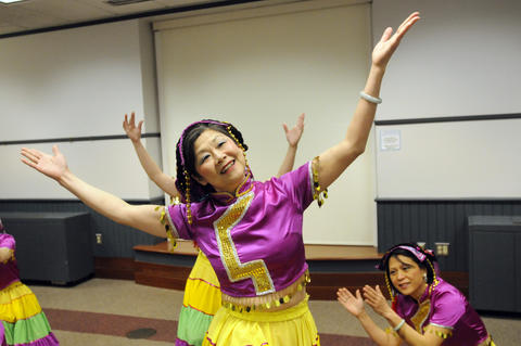 Julie Lai the head of The Asian Performing Arts group, leads rehearsal for their performance at the Enfield Heritage Fair at the Welles Turner Glastonbury Memorial Library in Glastonbury Wednesday Jan. 29.