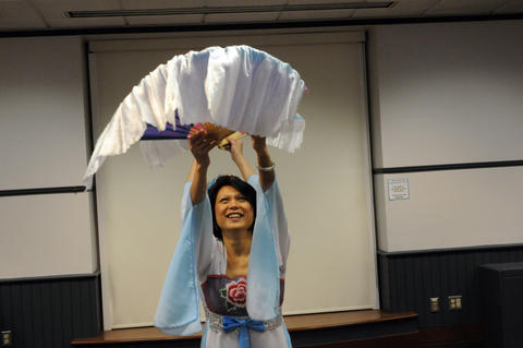 Loi Siew Cheah of Glastonbury, a member of The Asian Performing Arts group, rehearsed for their performance at the Enfield Heritage Fair at the Welles Turner Glastonbury Memorial Library in Glastonbury Wednesday Jan. 29.