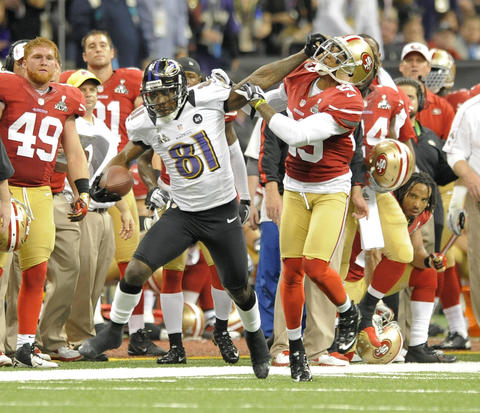 Ravens wide receiver Anquan Boldin stiff-arms San Francisco's Chris Culliver.