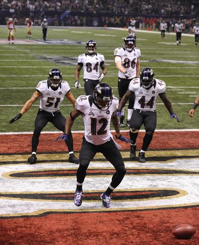 The Ravens celebrate Jacoby Jones' kickoff return touchdown.