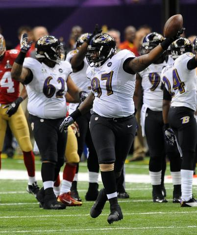 Ravens defensive lineman Arthur Jones comes up with a fumble in the second quarter.