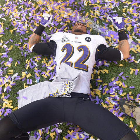Cornerback Jimmy Smith celebrates in a pile of confetti after the victory.