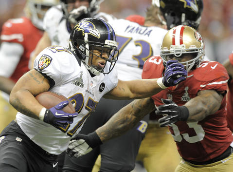 Ray Rice tries to fight off the tackle of 49ers linebacker NaVorro Bowman in the fourth quarter.