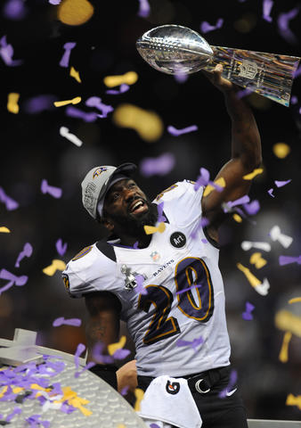 Safety Ed Reed hoists the Vince Lombardi Trophy.