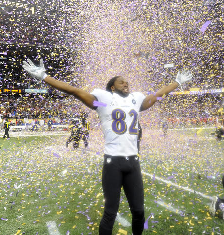 Wide receiver Torrey Smith basks in victory as confetti falls from the rafters.
