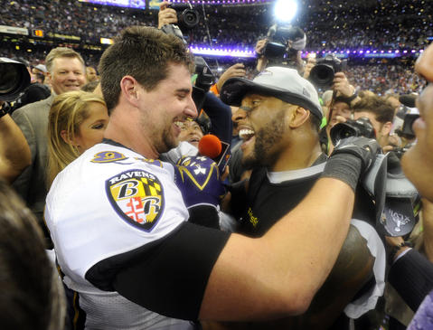 Dennis Pitta and Ray Lewis hug.