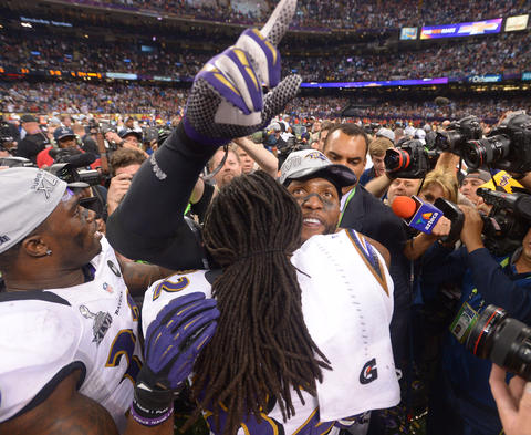 Ray Lewis hugs Torrey Smith during the celebration.