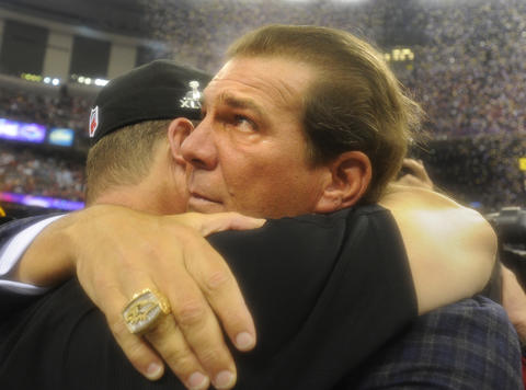 Ravens owner Steve Bisciotti sheds a few tears while hugging coach John Harbaugh.