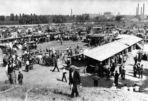 The Bonus Army camped on the bank of the Anacostia River in Washington, with the capitol in the background, in the summer of 1932. Troops set fire to the camp to drive the veterans from the area. Before the troops attacked the camp, 380 women and 488 children left, but nearly 6,000 men remained in it.
