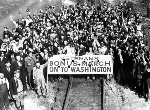 Unemployed war veterans tied up freight traffic on the Baltimore and Ohio railroad out of St. Louis on May 23, 1932 on their way to Washington to demand payment of their war bonus. Two hundred of the veterans were in East St. Louis with 200 more in Caseyville, Ill. This picture was taken in St. Louis where they arrived from Portland, Oregon, and other western points, commandeering box cars as they went.