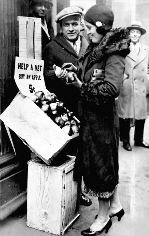 A young woman buys an apple from an unemployed veteran on South Wells Street in 1930.