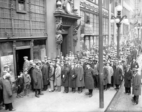 A crowd of World War I veterans wait in line at the Chicago Herald and Examiner newspaper's bonus bureau, circa March 4, 1931, for loans on their war bonus.