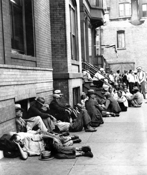 "Bonus Army vets, who arrived in Chicago from Johnstown, Pa., on Aug. 4, 1932, wait on the sidewalk in front of 17 W Pearson Street. Over 300 veterans arrived in five cars on the Baltimore and Ohio railroad with no plans and no arrangements for housing. According to the Tribune, ""The marchers were weak from lack of food and rested on the curb while food was being prepared in an emergency kitchen inside. Only a small portion of the (300) veterans were able to find sleeping quarters in the building and the others prepared to sleep on the sidewalks."" An anonymous donor gave the veterans permission to use the building."