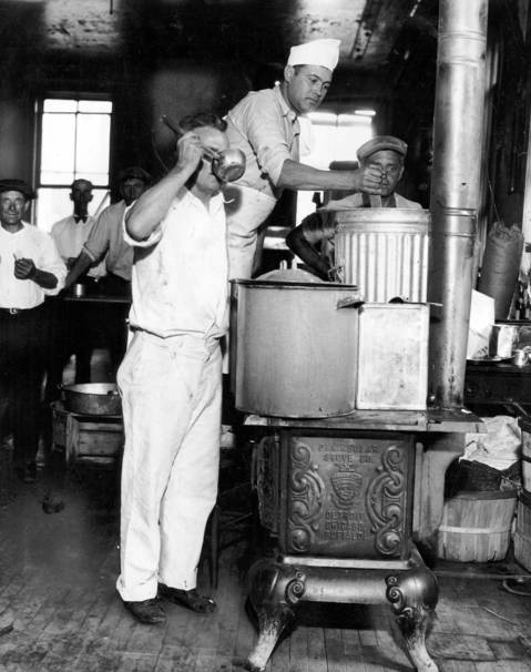 R.P. Ober, from left, Frank Rincione, and Jack Hartke prepare soup at the Bonus Army headquarters at 17 West Pearson Street on Aug. 9, 1932. The Bonus Army camp had been ordered closed as a fire hazard.