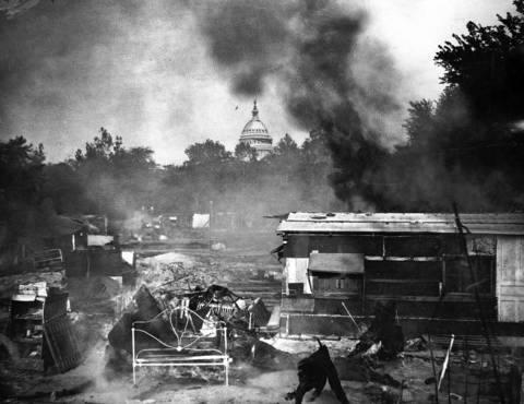 Smoke rises from the ruins of shacks where World War I veterans had made their homes in the summer of 1932. The former soldiers were driven from the Anacostia neighborhood after Congress voted down their request to be paid their bonus checks early.
