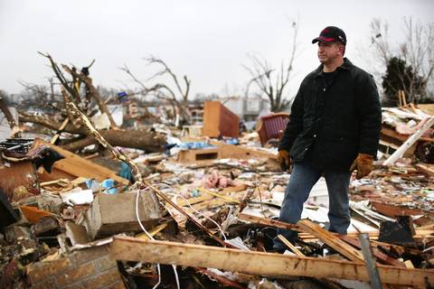 Curt Marshall, whose son Colton is the starting quarter back for the undefeated Washington High School Panthers football team, looks over the remains of their home which was destroyed in the previous week's tornado.
